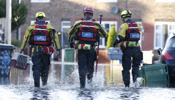 RSPCA Animal Rescuers wading through water