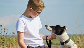 Boy outside with his greyhound ©RSPCA