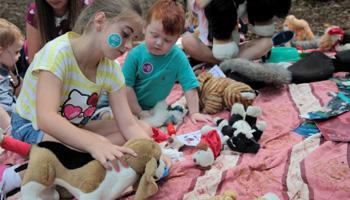 Children taking part in animal welfare workshops