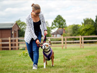 Teenage girl walking with staffy taking part in RSPCA Paws 4 Change programme ©RSPCA