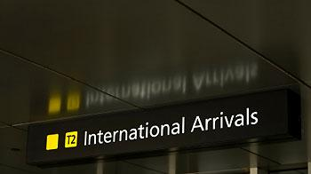 Airport sign for international arrivals © iStockphoto
