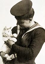 Sailor holding Minnie the cat after escaping a ship sunk by torpedo circa 1940 © RSPCA Photolibrary