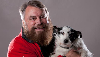 Brian Blessed holding a dog