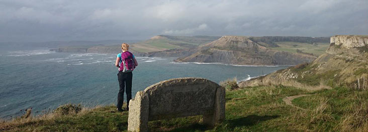 Hiker looking out over the Jurassic coast
