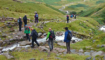 Hikers making their way through the Lake District