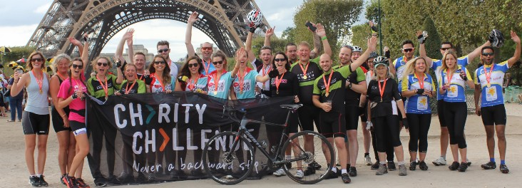 London to Paris participants celebrating completing the cycle