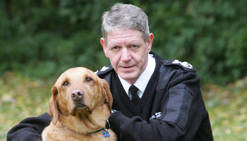 Scottish SPCA's Chief Superintendent, Mike Flynn, with a dog