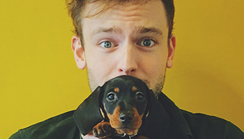 Dr Rory Cowlam holding a dog