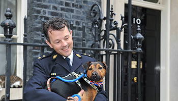 RSPCA Inspector and dog outside 10 Downing street © RSPCA Photolibrary