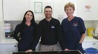 Volunteer Rob Milldown with clinic manager Sue Tyler and vet Jenny