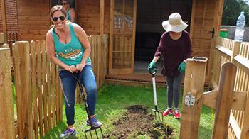 Corporate volunteer helping to dig © RSPCA