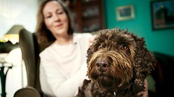 Rolo the dog with his owner © RSPCA