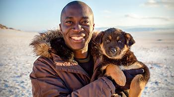 Patrick Ayree with a Bankhar puppy in Mongolia