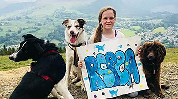 Libby Cantwell with three dogs © RSPCA