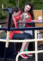 Mother and daughter with pet dog on a boat