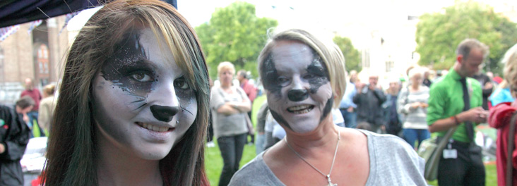 Stop The Cull demonstration campaigners with faces painted to resemble badgers © RSPCA photolibrary