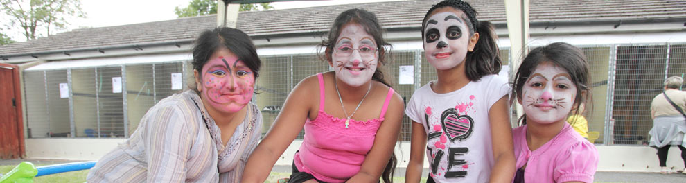 Children with painted faces at a community open day © RSPCA Photolibrary