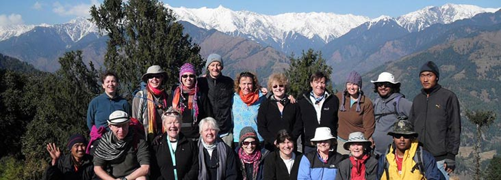 A group posing for a photo on the Himalayan Trek