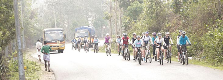 Group of cyclings on a road in India
