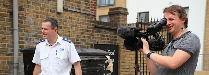 RSPCA Animal Collection Officerstanding with Sky television film crew © RSPCA photolibrary