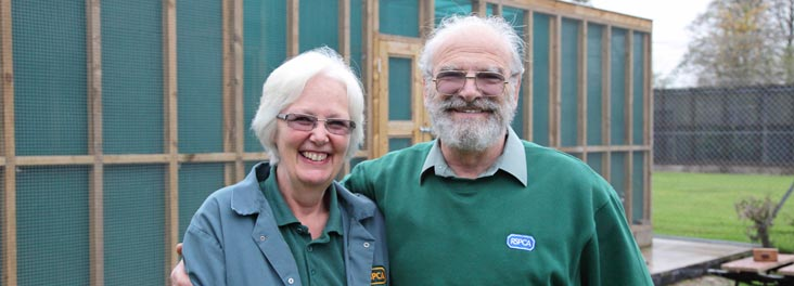 Portrait of RSPCA Volunteers, who built the bird aviary in the background Stapeley © RSPCA photolibrary