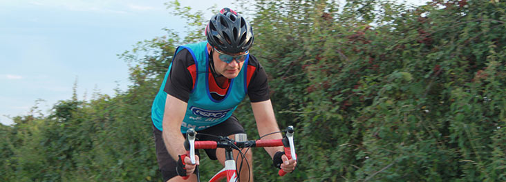 Cyclist wearing an RSPCA vest © RSPCA