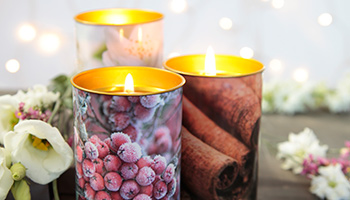 A set of three Christmas candles scented with cinnamon and cranberries © RSPCA