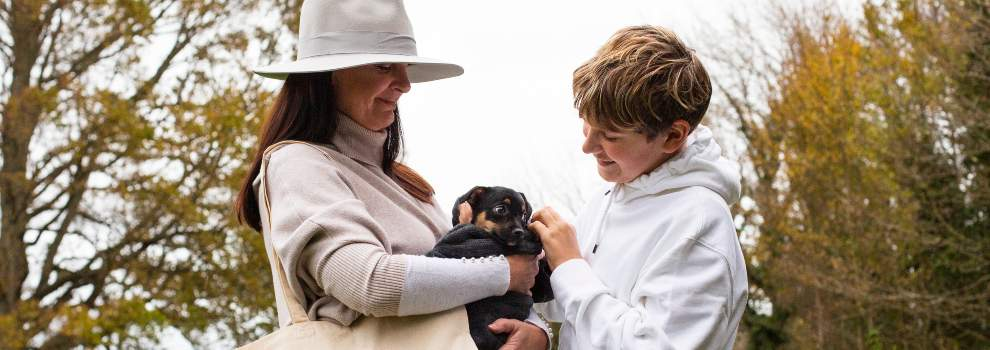 Mother and son holding a puppy